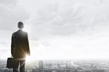 marketing strategy: Rear view of businessman looking at business marketing strategy