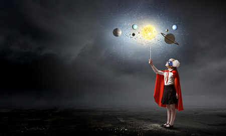space age: Cute girl of school age exploring space system Stock Photo