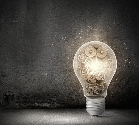 Concept of mechanism light bulb with gears inside