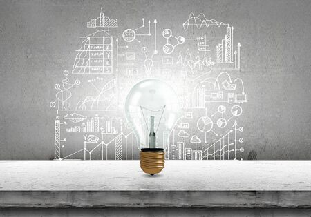 Conceptual image of light bulb on wall with sketches of ideas stock conceptual image of light bulb on wall with sketches of ideas stock photo 42392441 aloadofball Gallery
