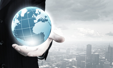 business connection: Close up of businessman hand showing digital earth globe