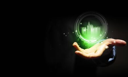 vision: Close up of businessman hand holding digital construction model