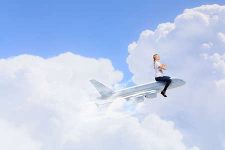 Young woman riding drawn airplane flying in air