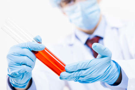 biochemist: Young scientist making chemical tests in laboratory Stock Photo