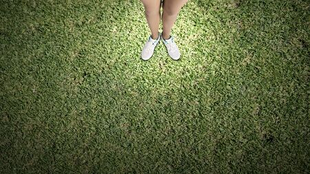 unskilled: Top view of female legs in white sport shoes