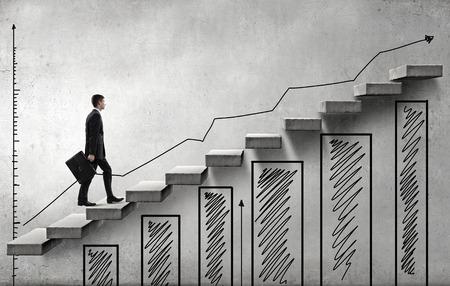 青年実業家の成功の概念を表す階段の上歩く 写真素材