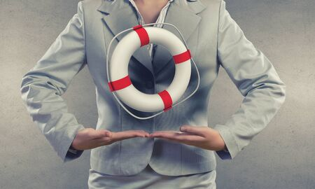 life guard stand: Close up of businesswoman with life buoy in hands