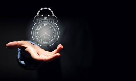 classical mechanics: Close up of businessman hand showing clock watch symbol