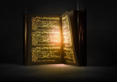 Antiguo libro mágico negro con luces en las páginas Foto de archivo - 42739408