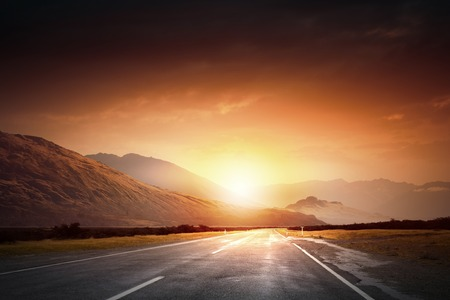 beginning: Empty asphalt road and sun rising at skyline