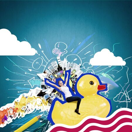 silly: Silly young businesswoman in work break riding on plastic duck Stock Photo