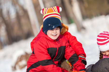 snowballs: Children in winter park having fun and playing snowballs