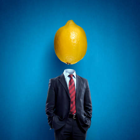 lemon: Headless businessman with lemon instead of head