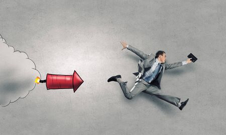 speedy: Young speedy businessman running in a hurry