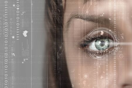 Close up of womans eye scanned for access