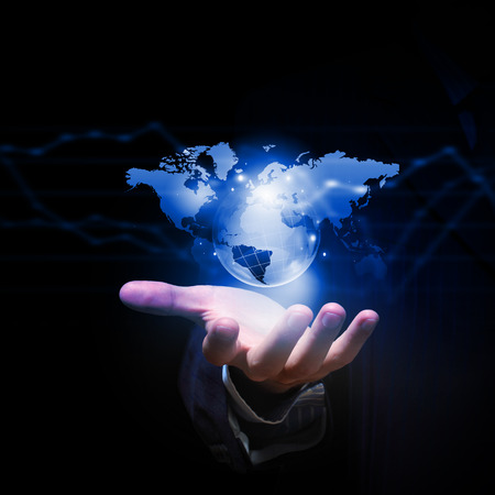 network connections: Close up of businessman hand showing digital planet