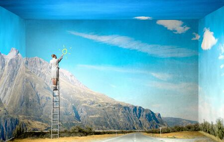 ladder of success: Businesswoman standing on ladder drawing sun on wall
