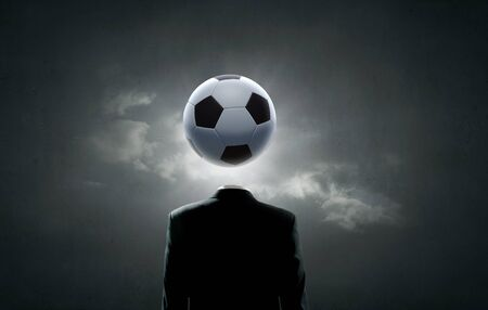 unrecognizable: Unrecognizable man with soccer ball instead of head Stock Photo