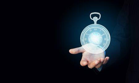 classical mechanics: Close up of businessman hand showing pocket watch symbol Stock Photo