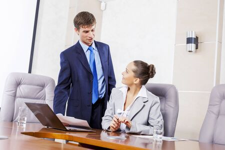 lady boss: Young businessman showing lady boss business documents