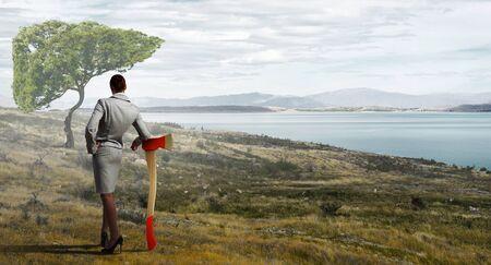 deforestacion: Empresaria con el hacha que representa un problema de la deforestaci�n Foto de archivo