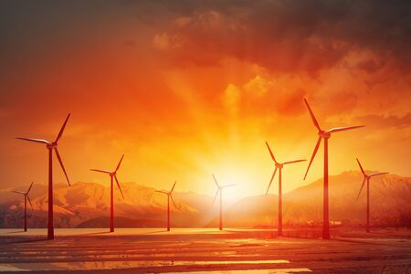 electricity generator: Concept of alternative electricity power with windmills on sunset background