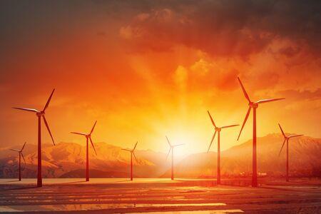 electricidad: Concepto de energ�a el�ctrica alternativa con molinos de viento en el fondo del atardecer