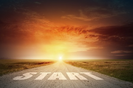 conceptual image: Conceptual image with word start on asphalt road
