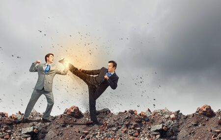 two people: Two businesspeople in anger fighting with each other