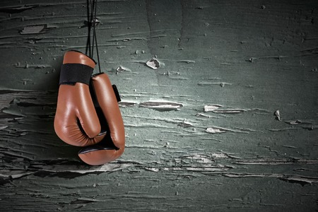 boxing: Boxing gloves hanging on nail on wall Stock Photo