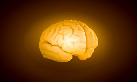 losing memories: Science image with human brain on yellow background Stock Photo