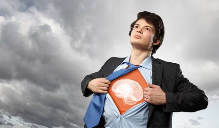 スーパー ヒーローのような演技の胸に彼のシャツを開いて実業家 写真素材