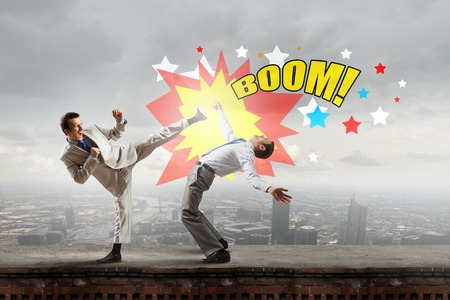 fight: Two businesspeople in anger fighting with each other
