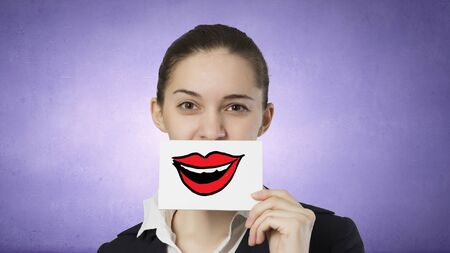 smilie: Pretty young girl holding white card with drawn smile