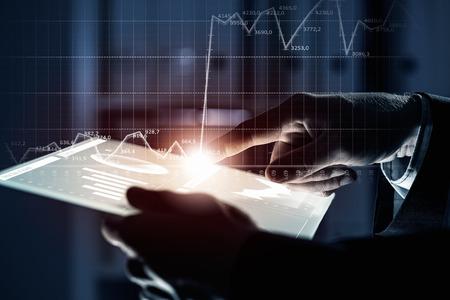 finance: Close up of human hands using virtual panel