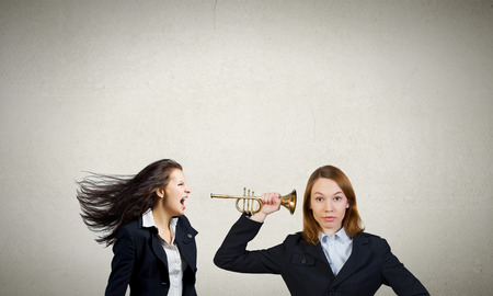 reprimand: Businesswoman scream agressively in horn at another woman