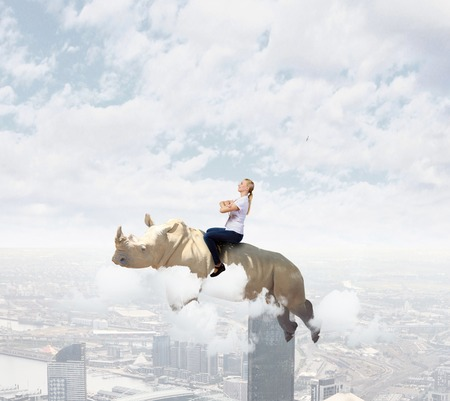 fearless: Young pretty fearless woman riding huge flying