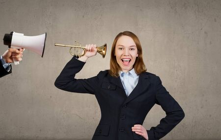 businessman using a megaphone: Businessman using megaphone to scream agressively at woman