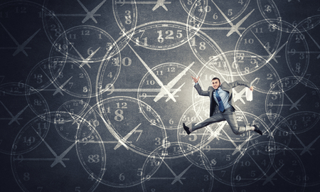 man business: Concept of time with funny businessman running in a hurry