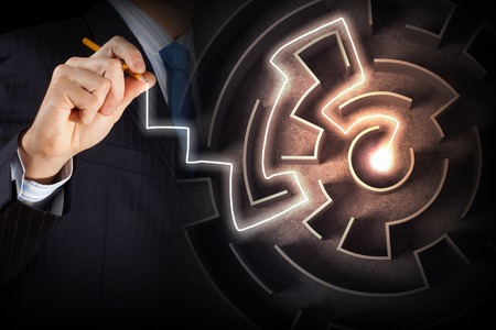 challenge: Close up view of businessman drawing way in labyrinth