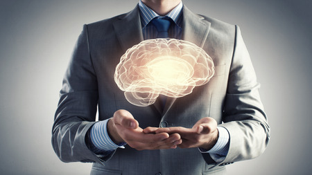 human palm: Close up of businessman holding digital image of brain in palm Stock Photo