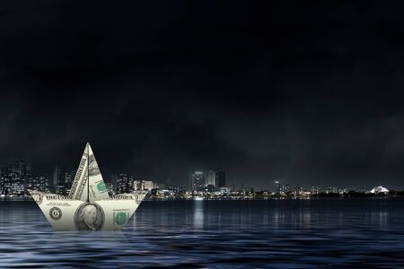 losing money: Ship made of dollar banknote floating in water
