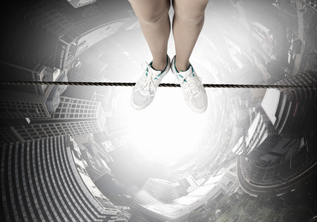 slack: Top view of person standing on rope above city