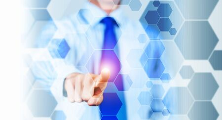 business innovation: Close up of businessman touching digital screen with finger Stock Photo