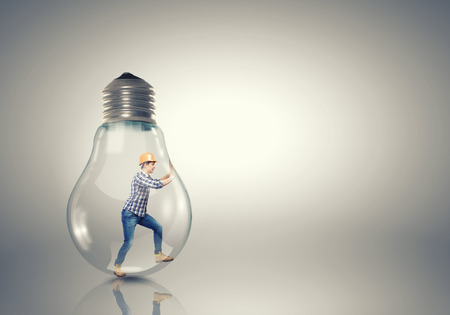get out: Builder man inside light bulb trying to get out