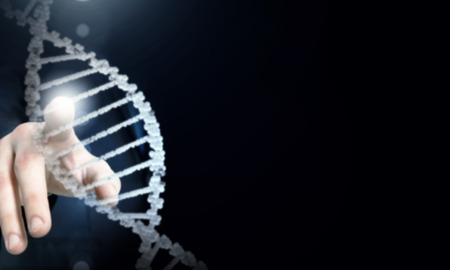Science concept image of human hand touching DNA molecule Stock Photo