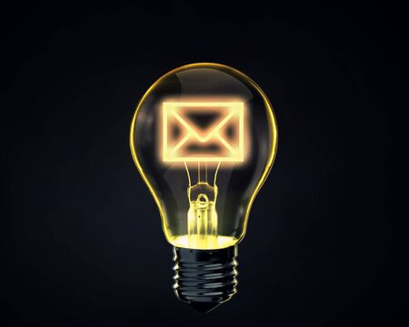 addressee: Light bulb with mail sign inside on dark background Stock Photo