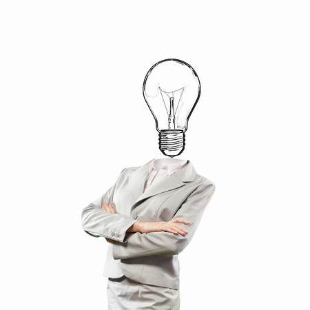 cabeza femenina: Unrecognizable businesswoman with light bulb instead of head