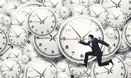 clock work: Concept of time with funny businessman running in a hurry
