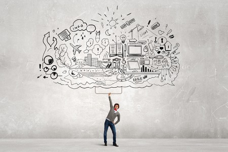 analyze: Young businessman lifting his great business plan above head Stock Photo
